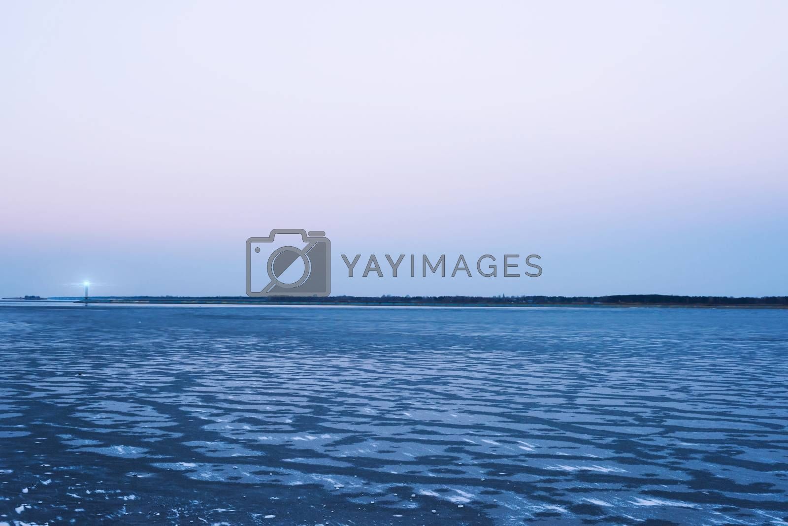 Frozen sea, the lighthouse, evening sky  romantic