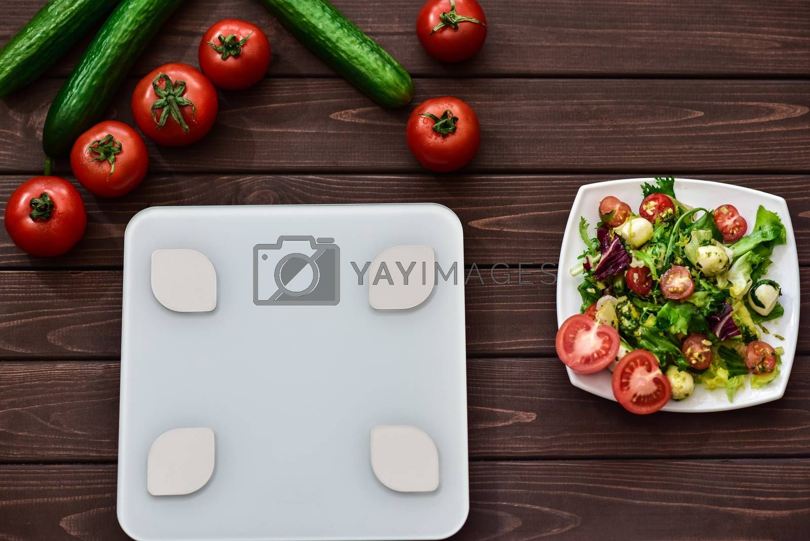 dieting and control calories for good health concept. salad. smart weight scales. veggies on board. fitness concept.