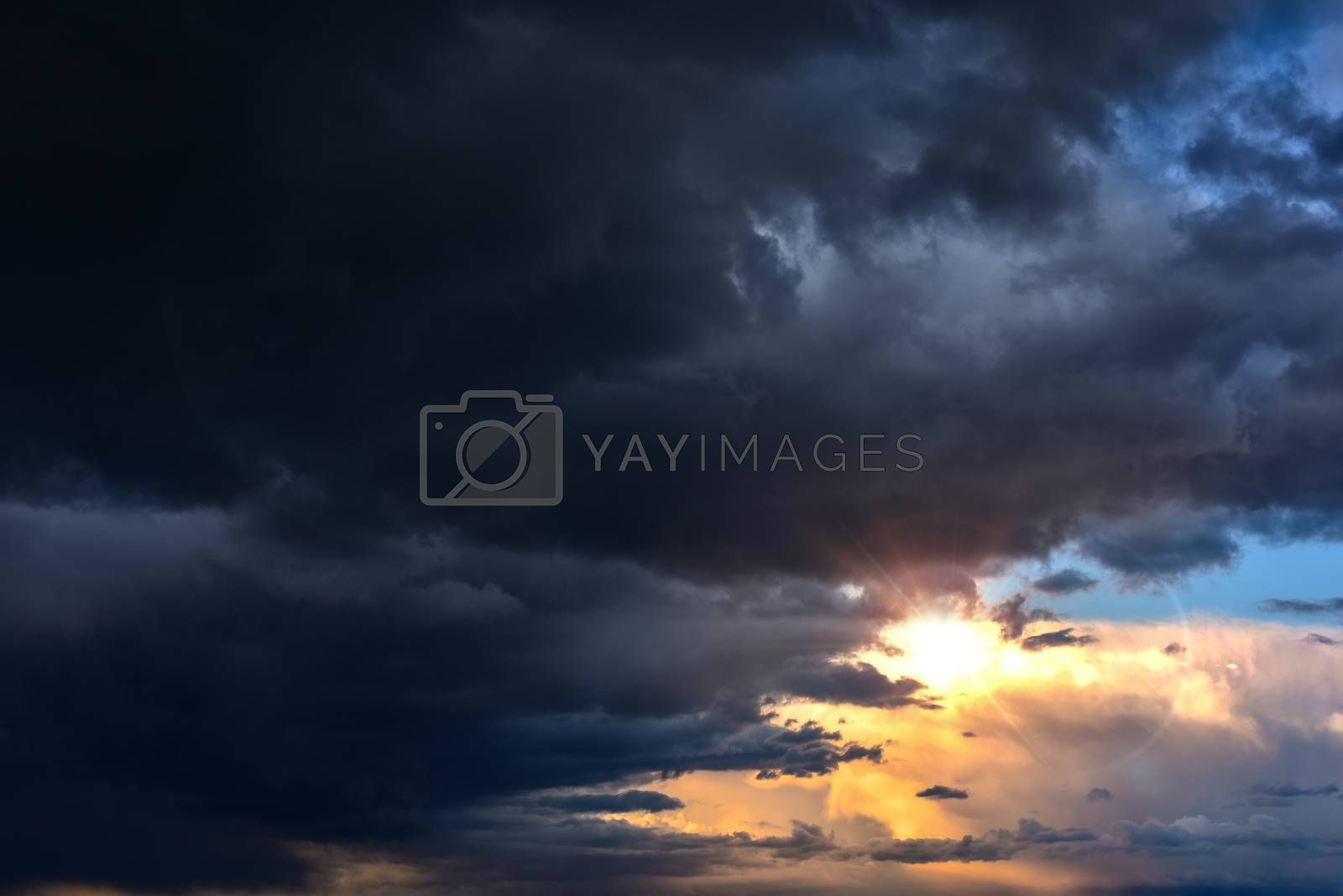 Beautiful clouds, darkness closes Sun, the light shines in the darkness godrays