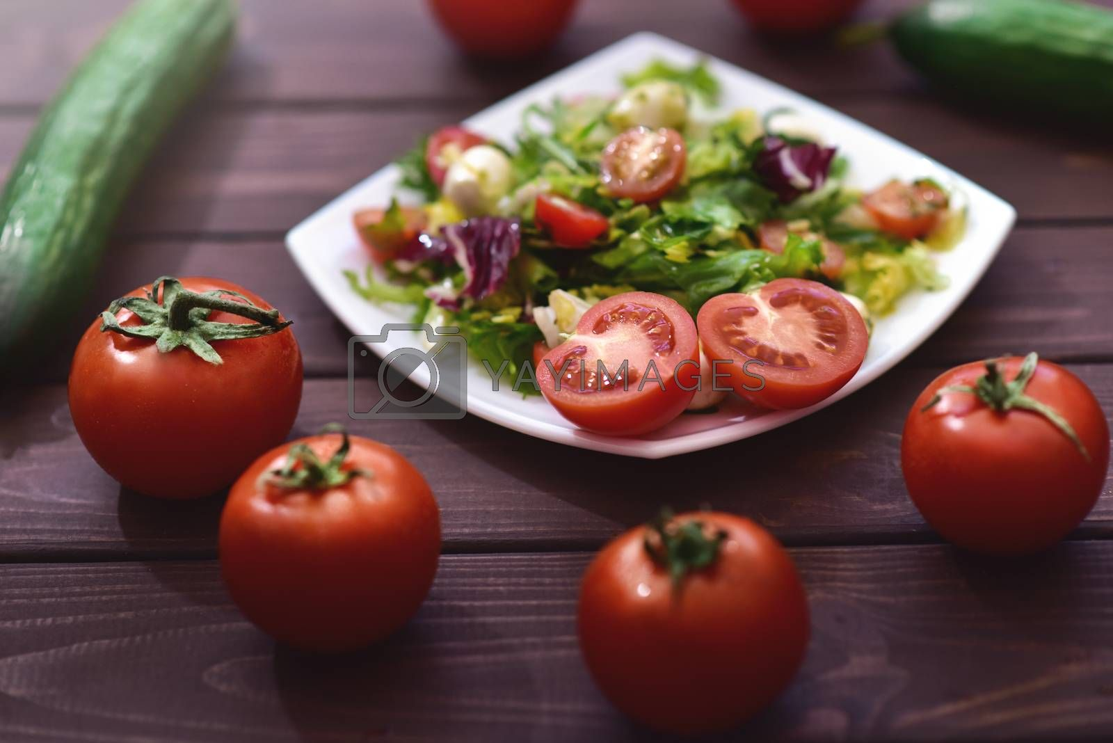 Healthy dietary meals. Mix salad of vegetables on a wooden background. Hello spring. Healthy body