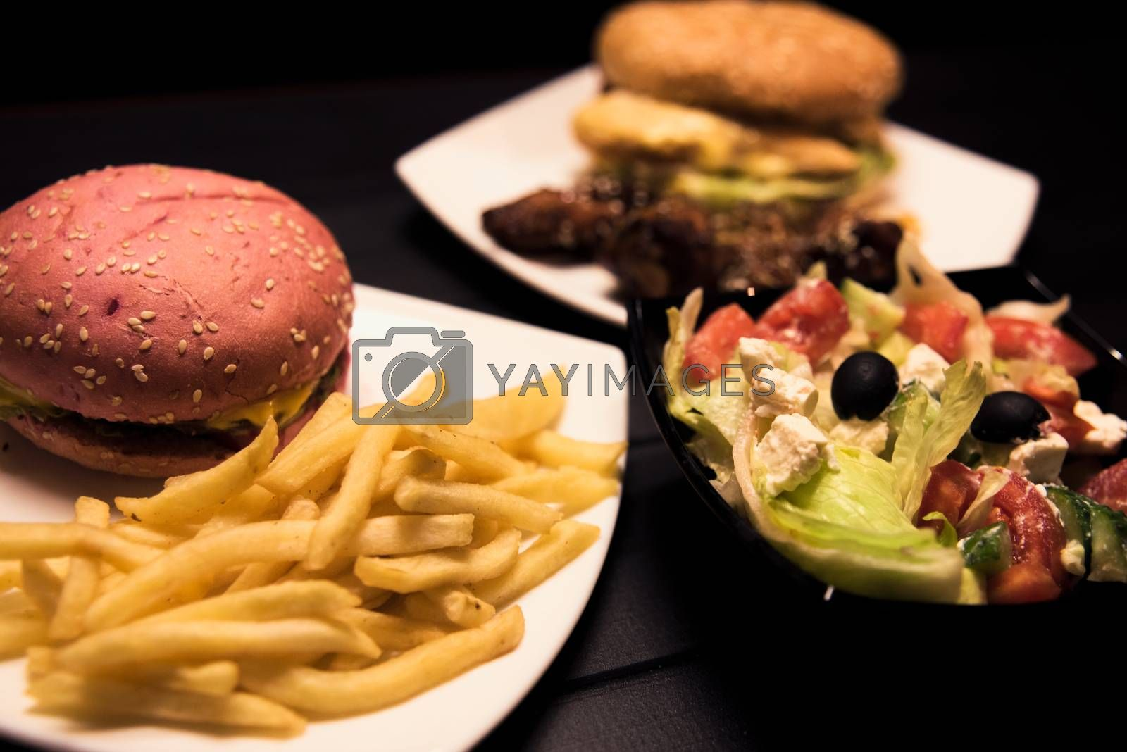 Fast food,tasty food, street food, grilled chicken,burgers, French fries, salad by Nickstock