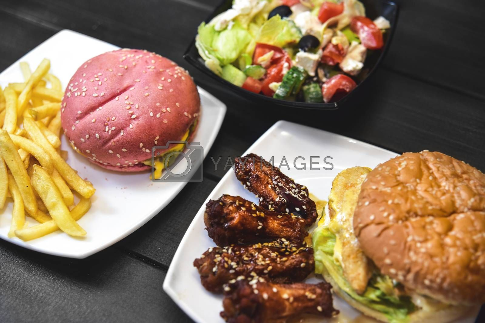 Fast food, tasty food, street food, grilled chicken, burgers French fries salad
