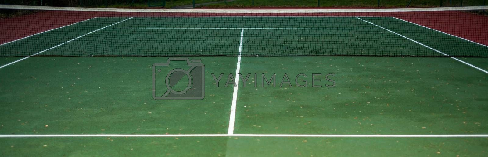 Empty tennis court available for the public, photographed in the evening