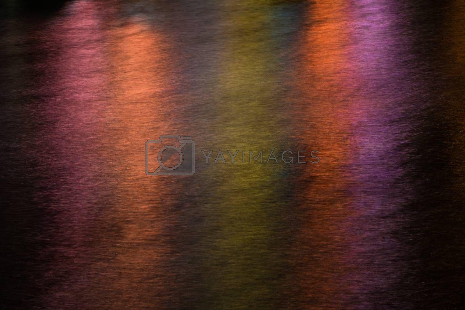 Abstract multicolour lights pattern created on a river surface