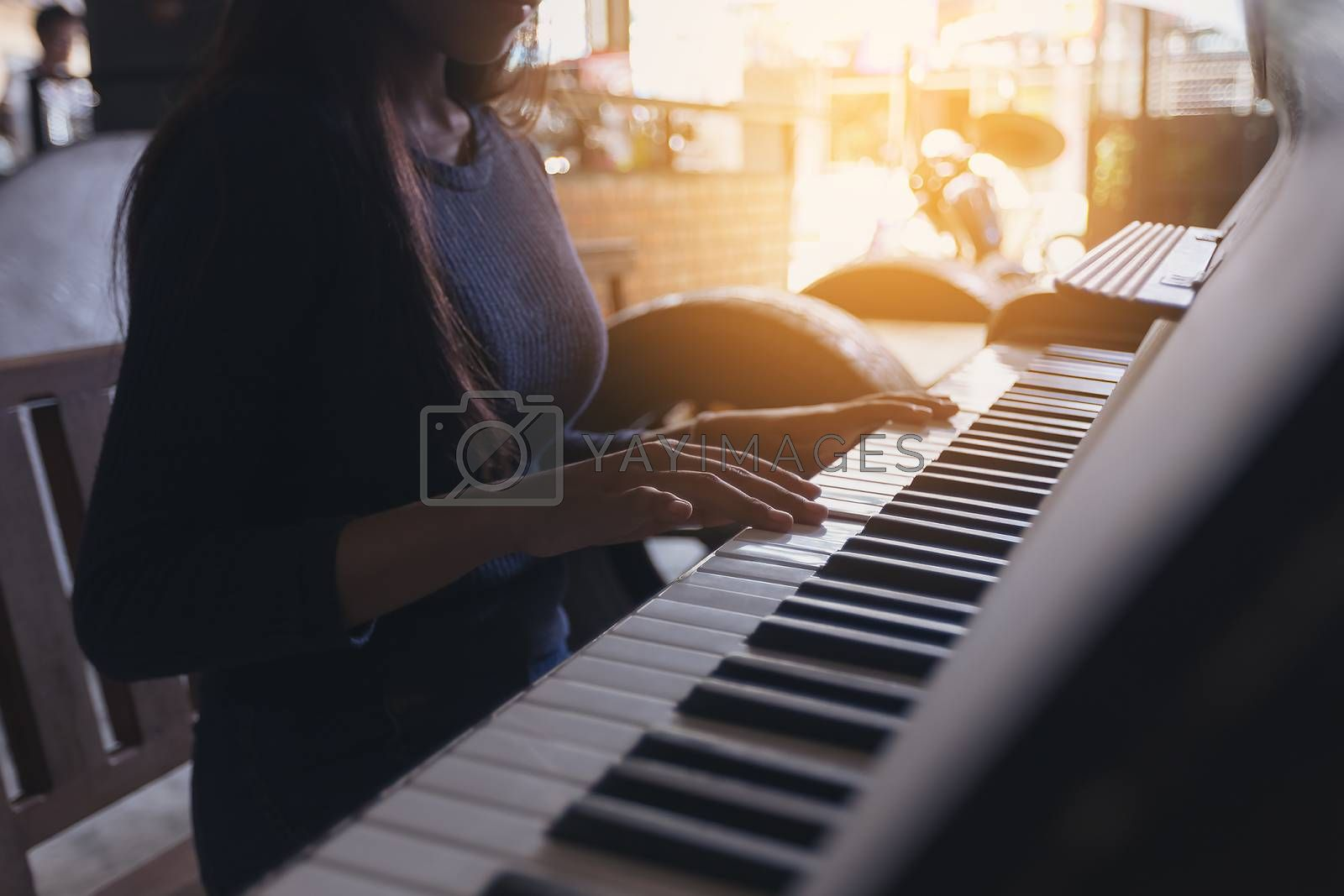 Female hand playing piano, Concept of relax by numberone9018