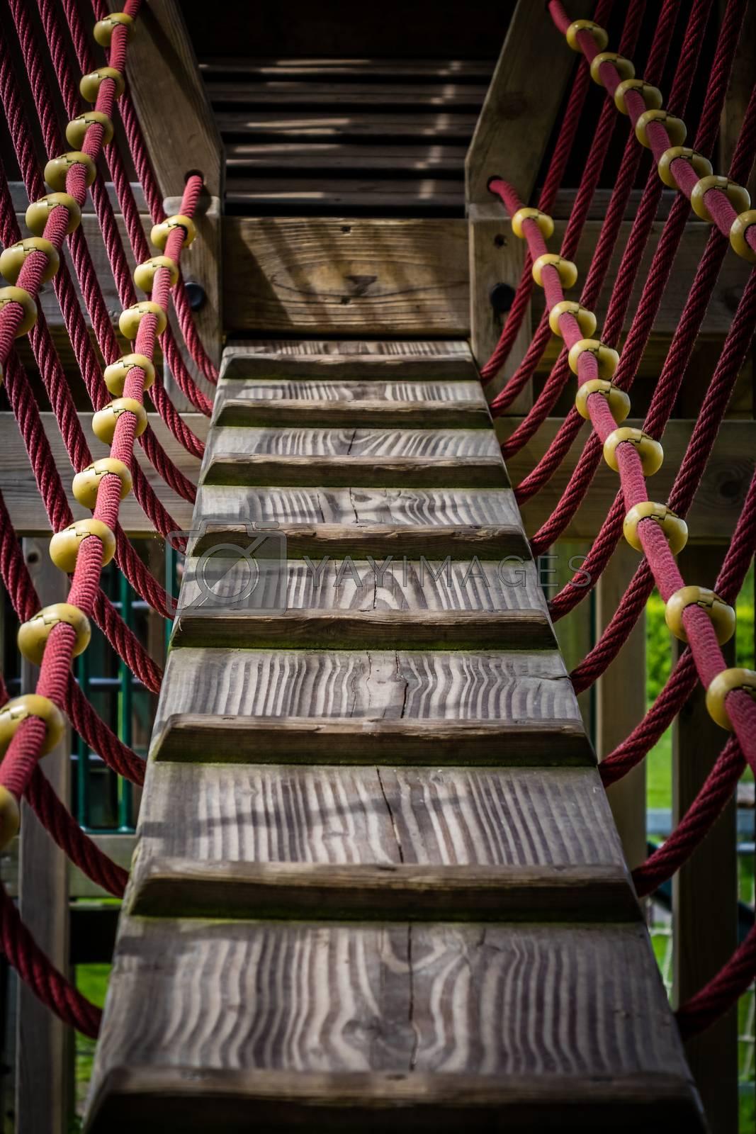 Wooden hanging bridge on a kids playground