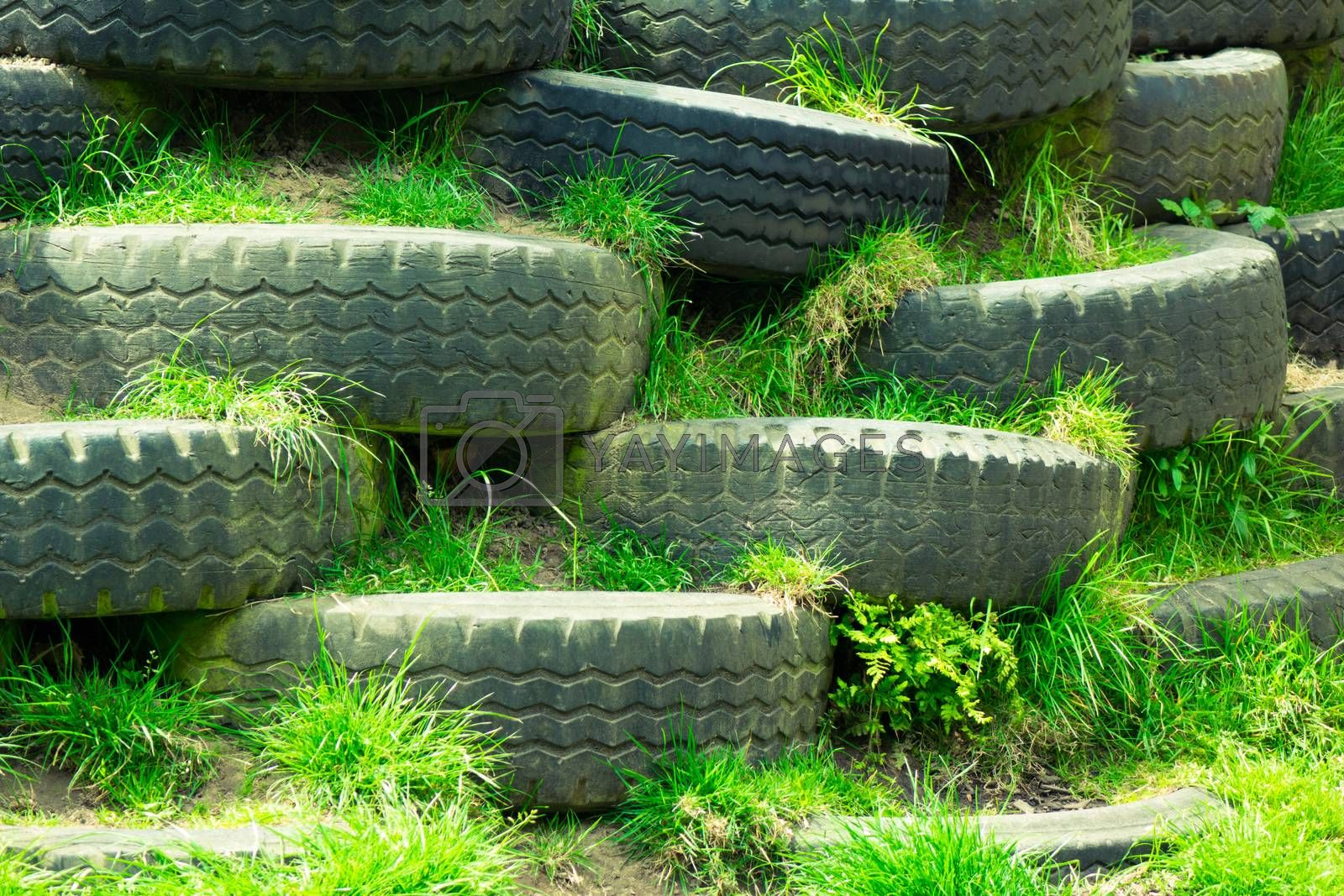 Climbing wall of old disused tyres in an outdoor children playground