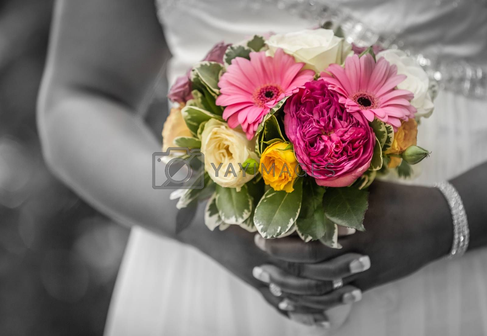 Bride holding a wedding bouquet in her hands