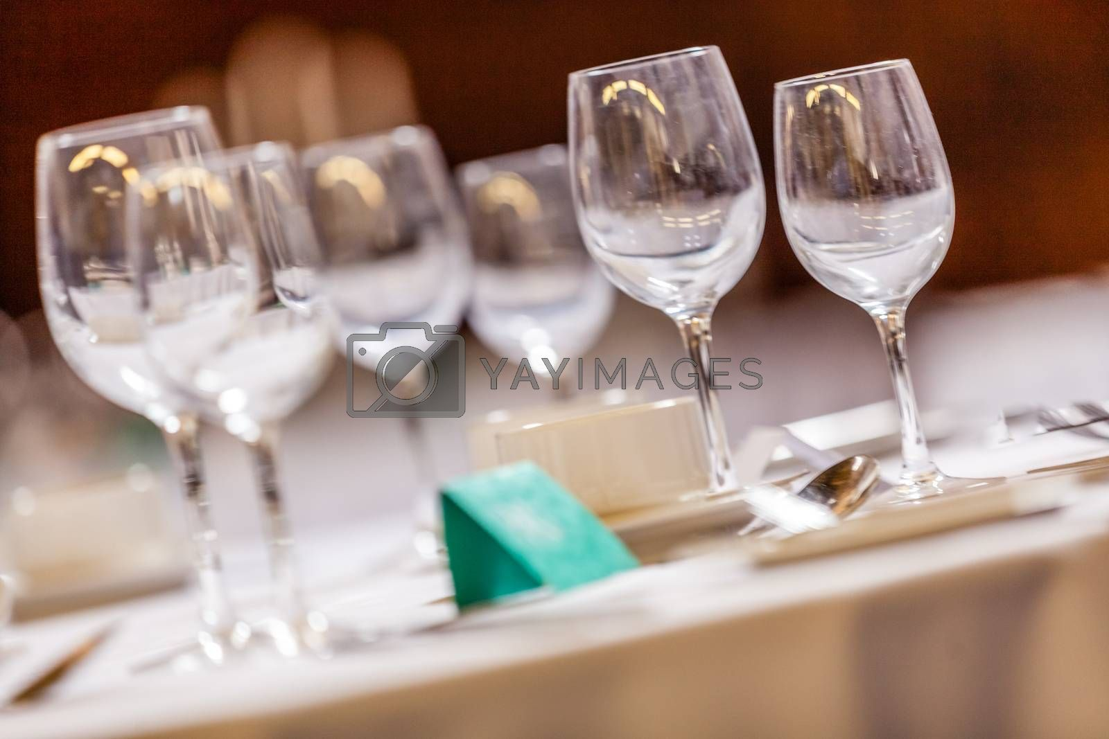 Wine glasses on the table before wedding dinner