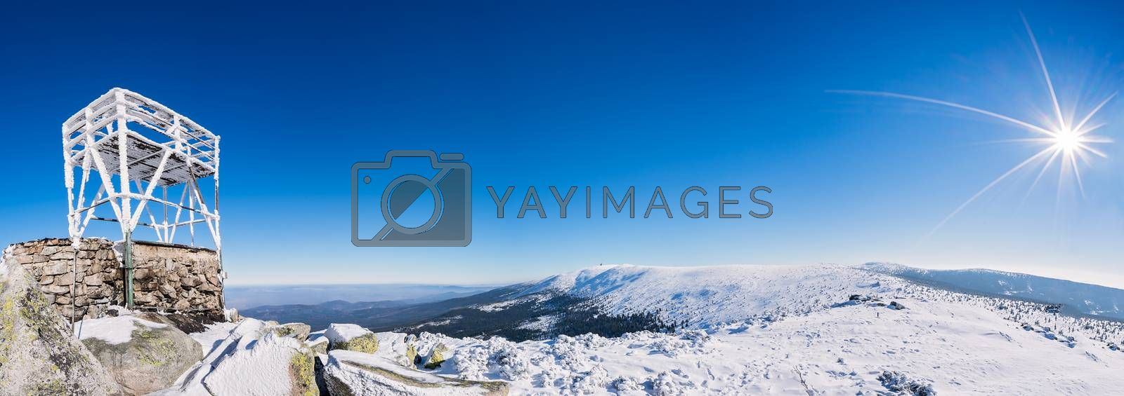 Panoramic view of a Karkonosze mountains with a viewing platform on the slope of Szrenica mountain in the foreground, Poland