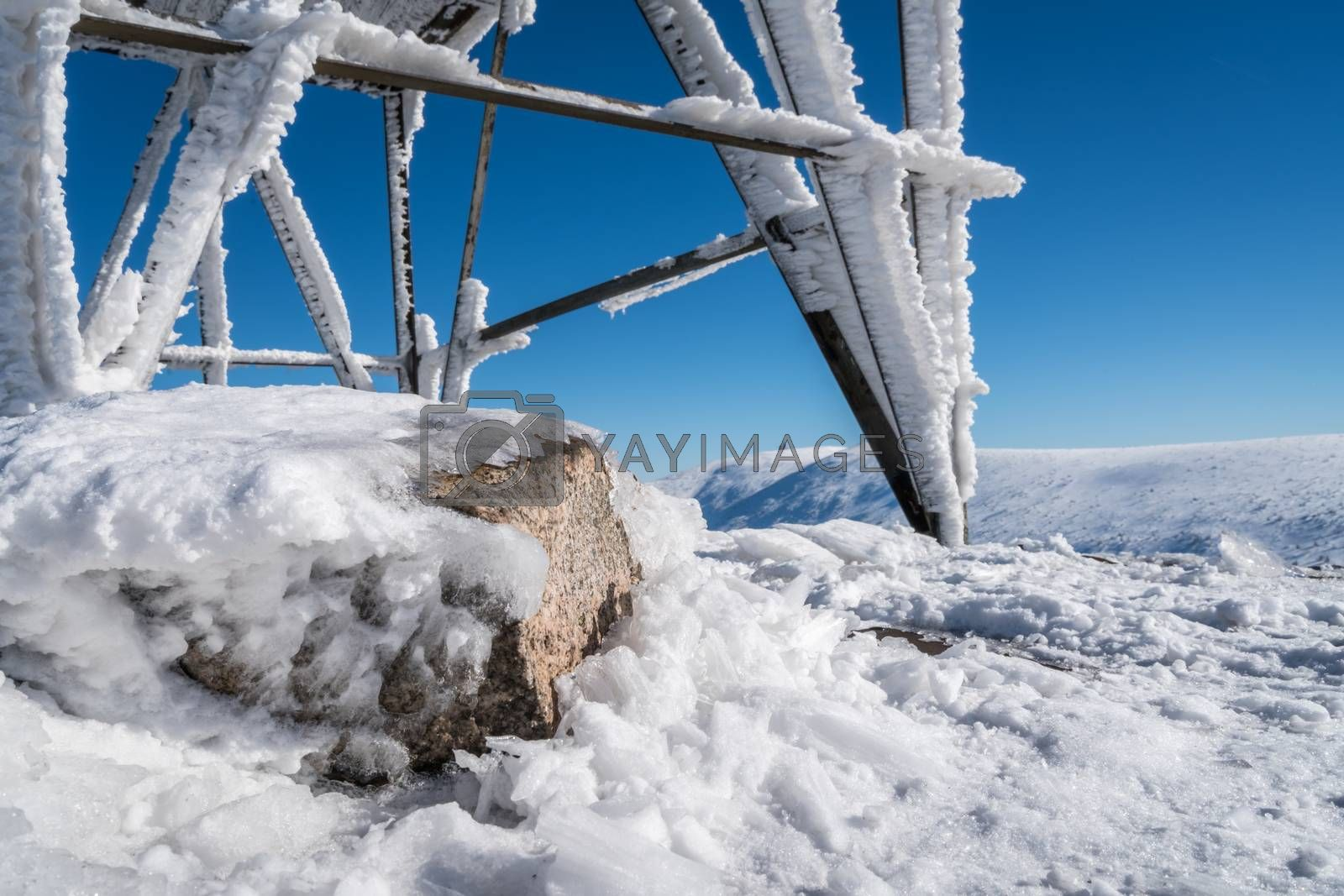 Covered in frost and ice weather viewing platform on the top of Szrenica mountain in Karkonosze, Poland