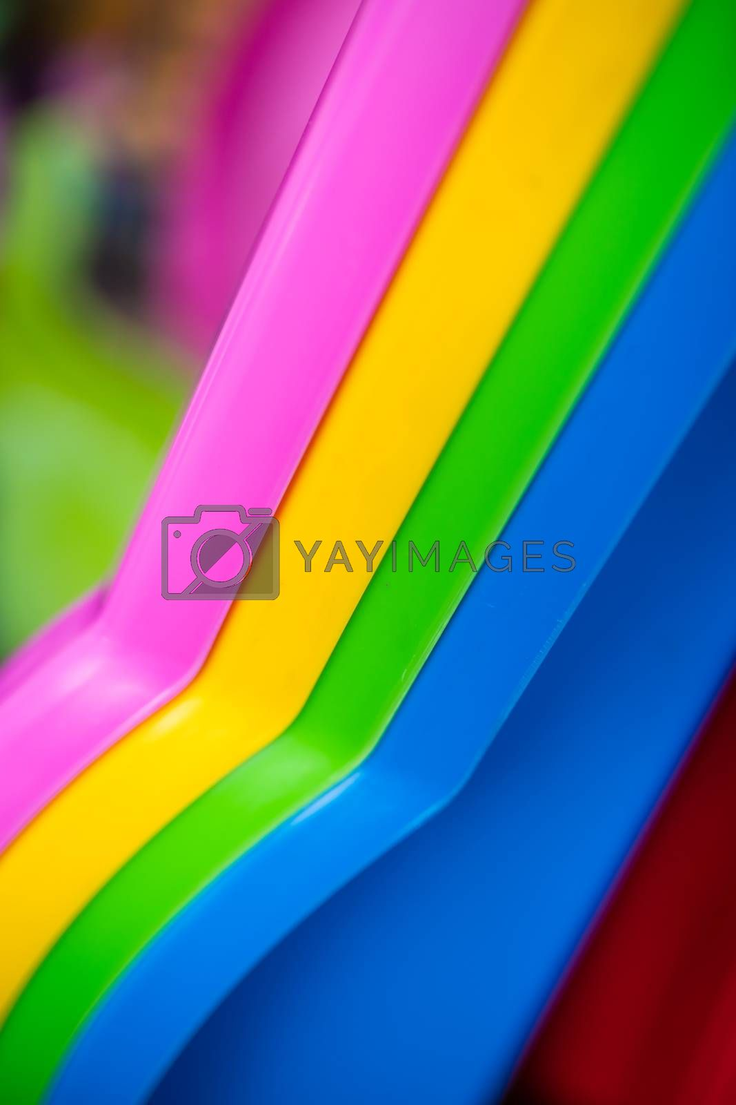 Background of the colorful sides of plastic sleds