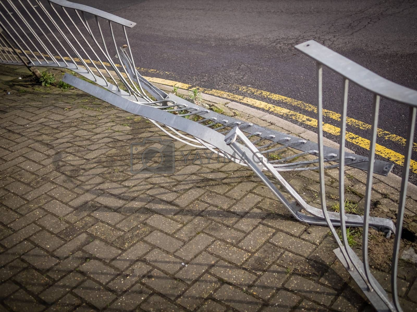 Damaged steel railing after car accident, London suburb