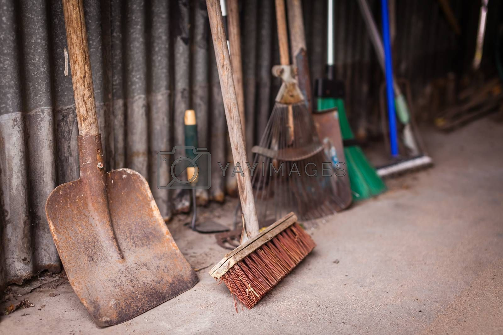 Old and rusted garden tools in an old garage