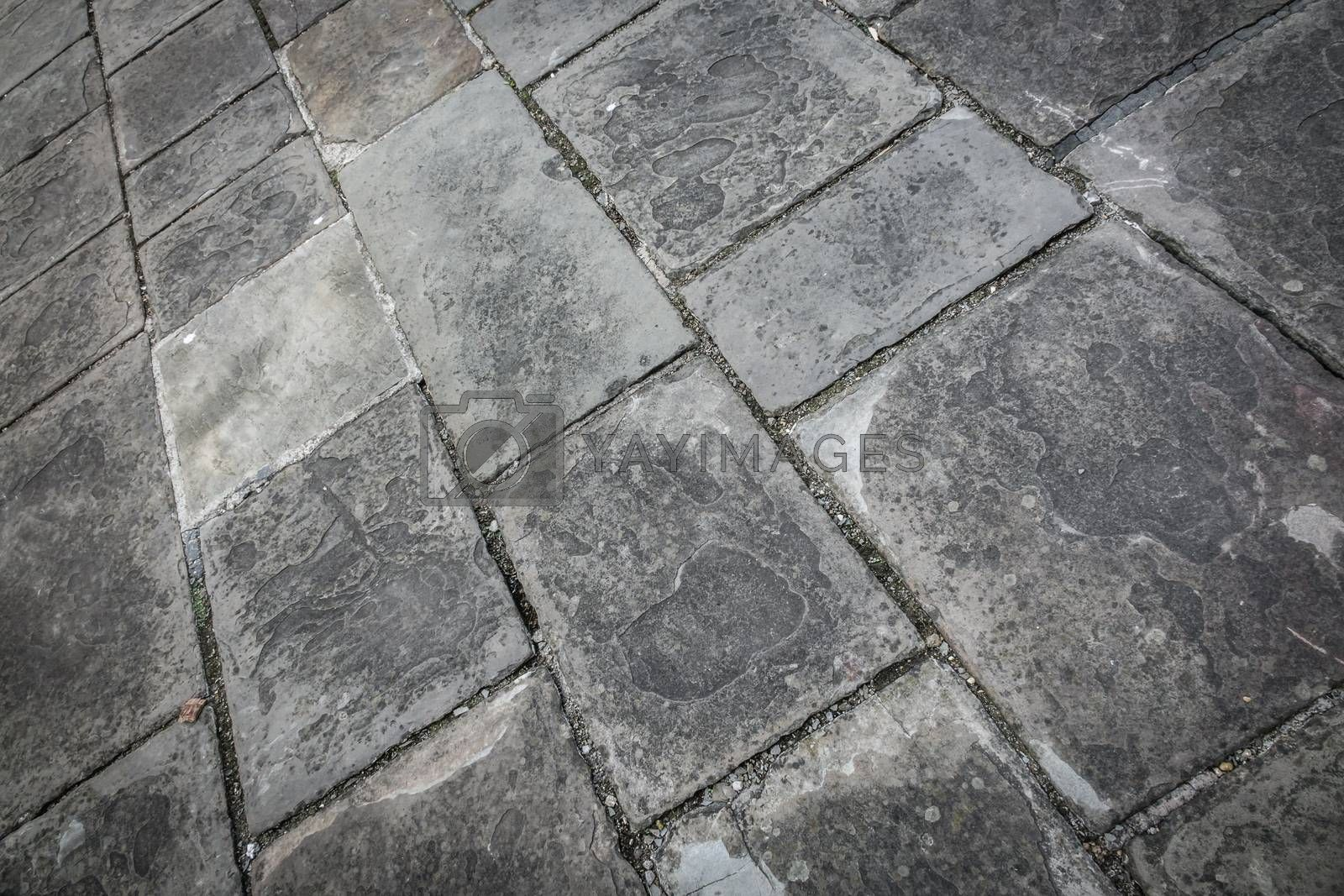 Rectangular pattern of a stony pathway on the street