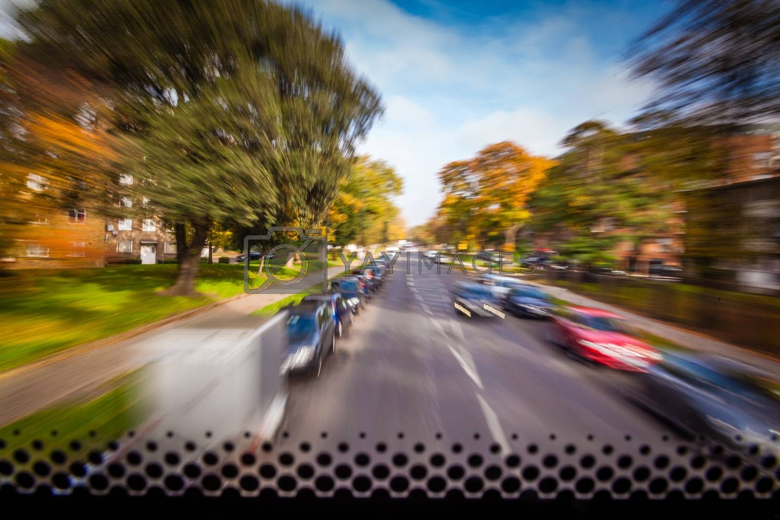 Dynamic picture of a London street taken from a front window of a doubledecker bus