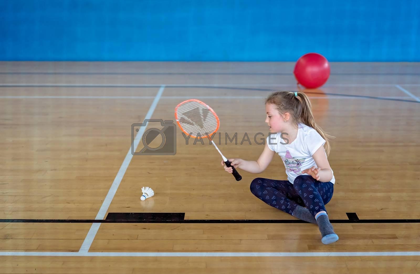Little Caucasian girl playing badminton by pawopa3336