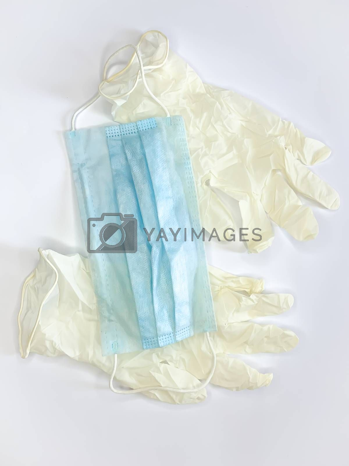 Antibacterial medical mask of blue color and gloves on a white background virus epidemic corona virus protection