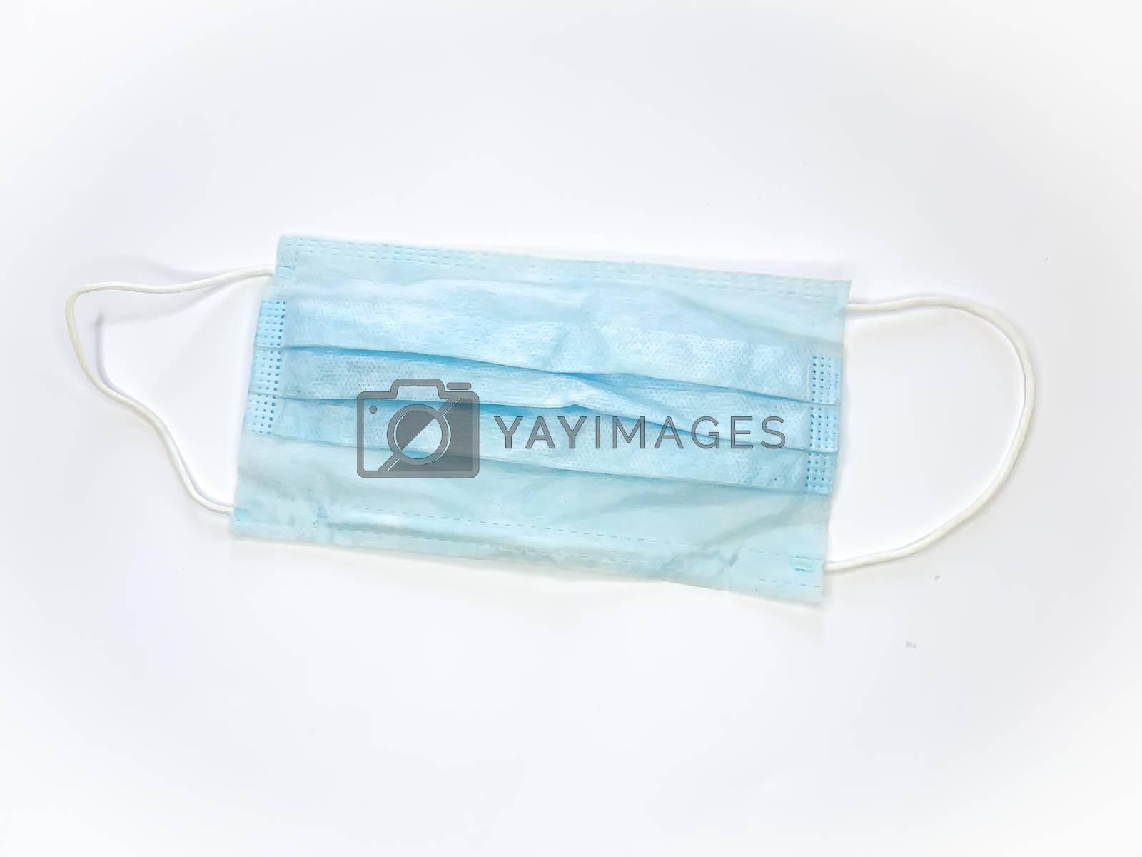 Antibacterial medical mask of blue color on a white background virus epidemic corona virus protection