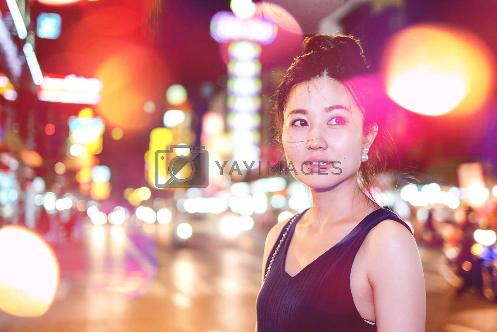 Girl walking on the night city street