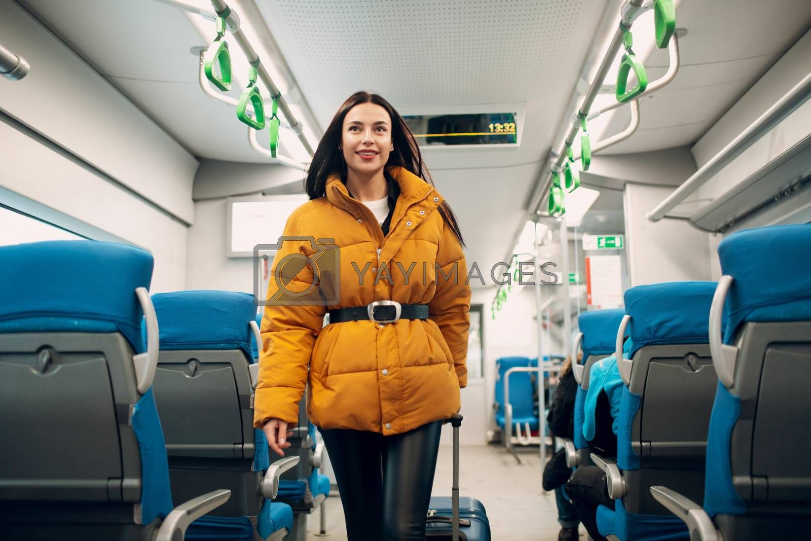 Happy young woman and train