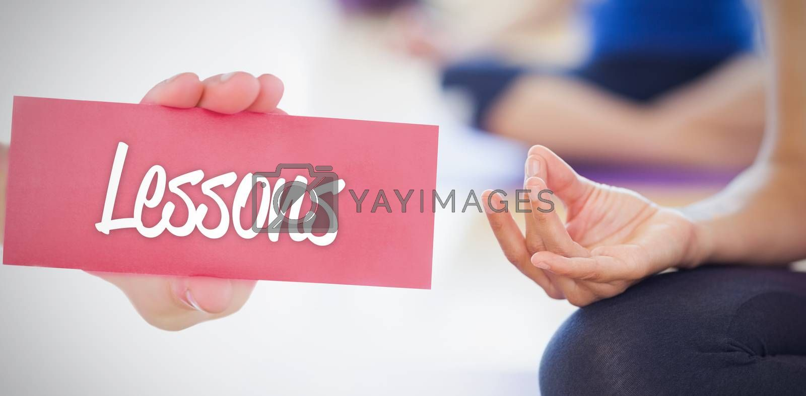 The word lessons and hand showing card against