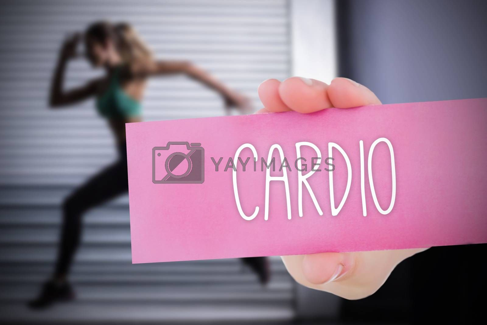 The word cardio and young woman holding blank card against