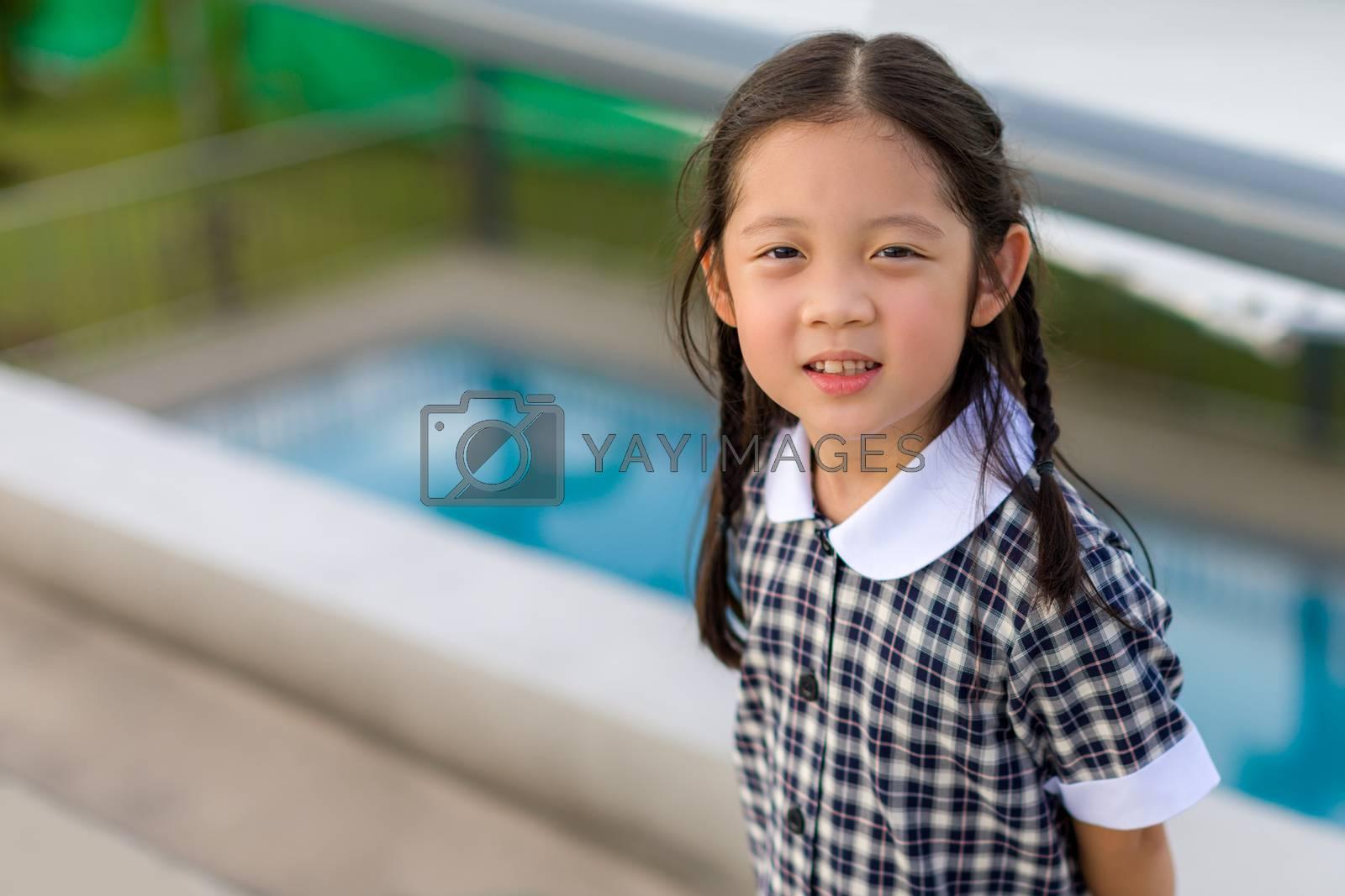 Smiling child, girl, in school uniform portrait.