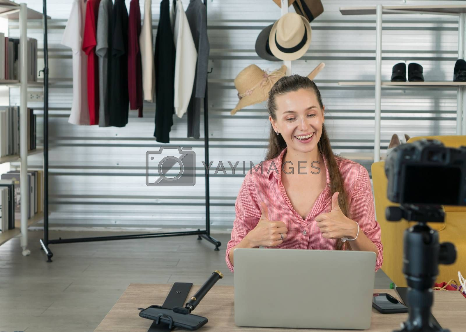 Beautiful Caucasian women are having fun and being happy at work. He is a product reviewer on YouTube.( Mock up books )