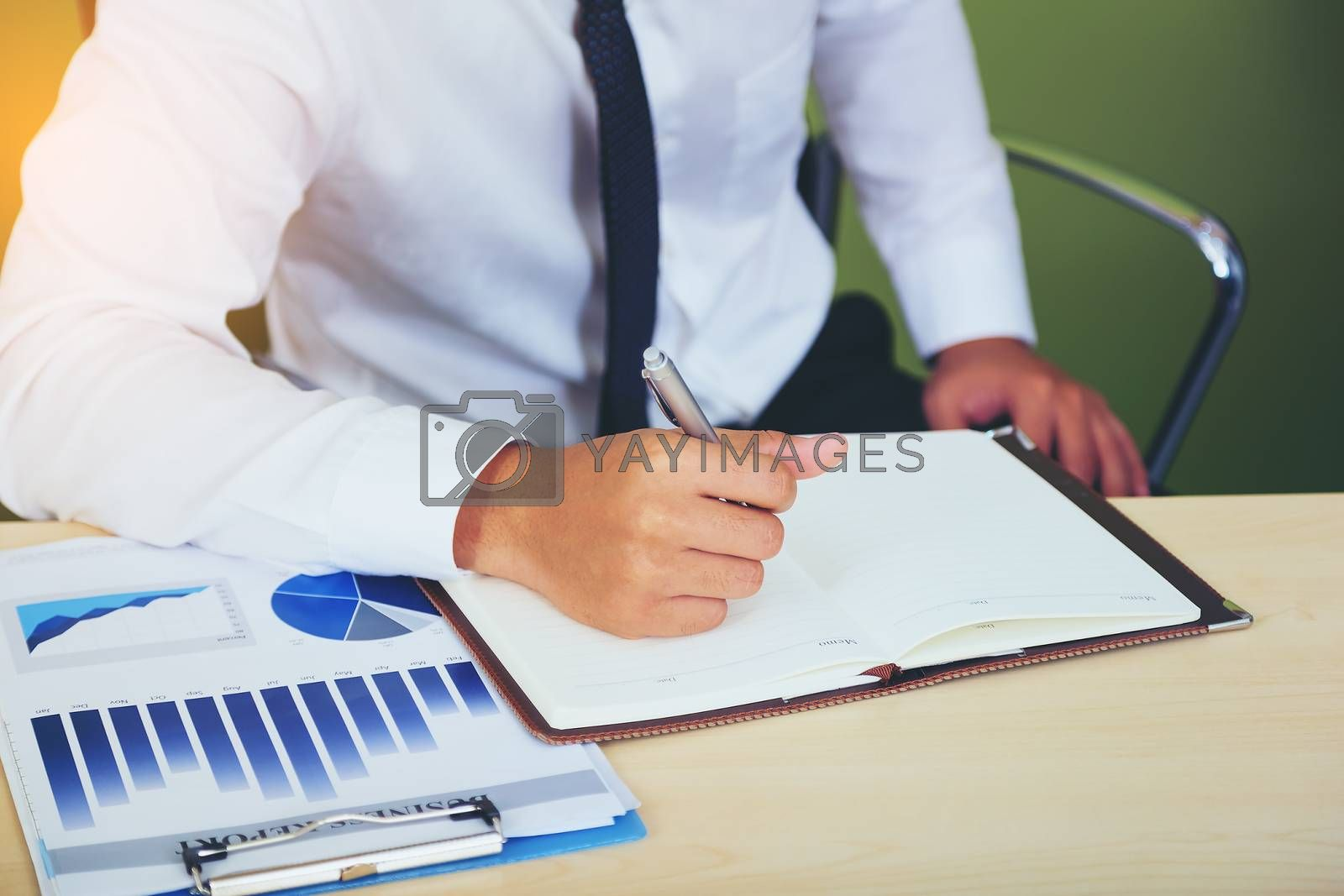 Portrait of investment agent consulting with his client while sitting at office
