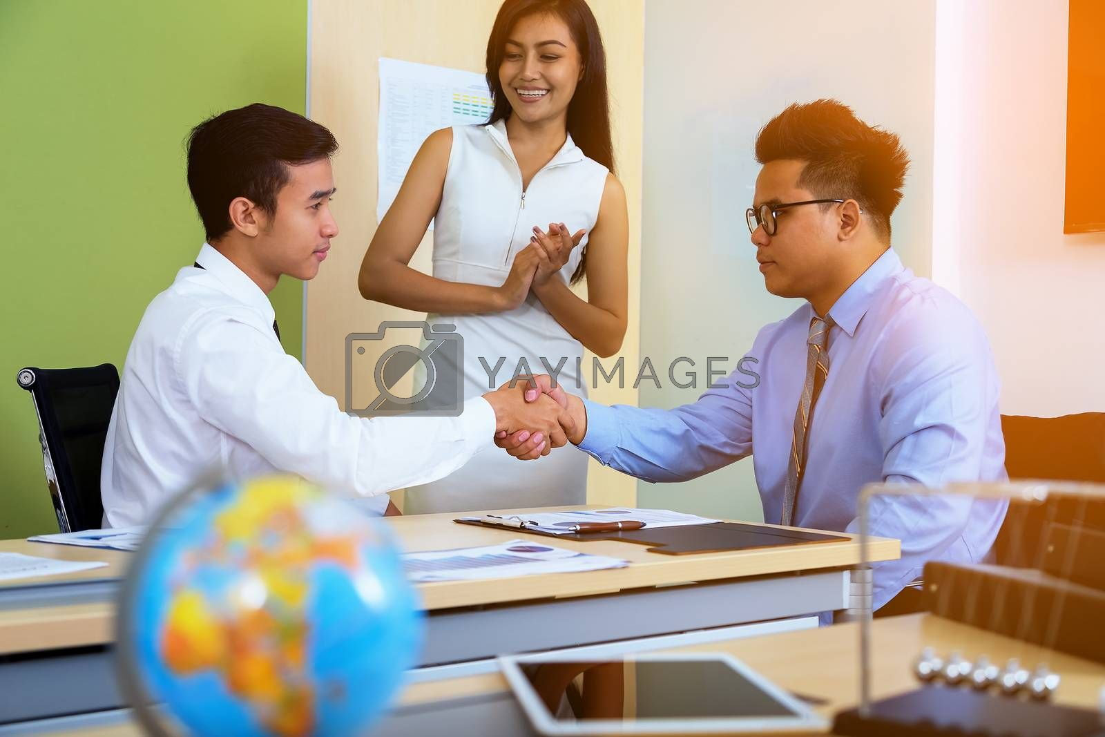Image of a businessman joining hands after agreeing to a business deal.