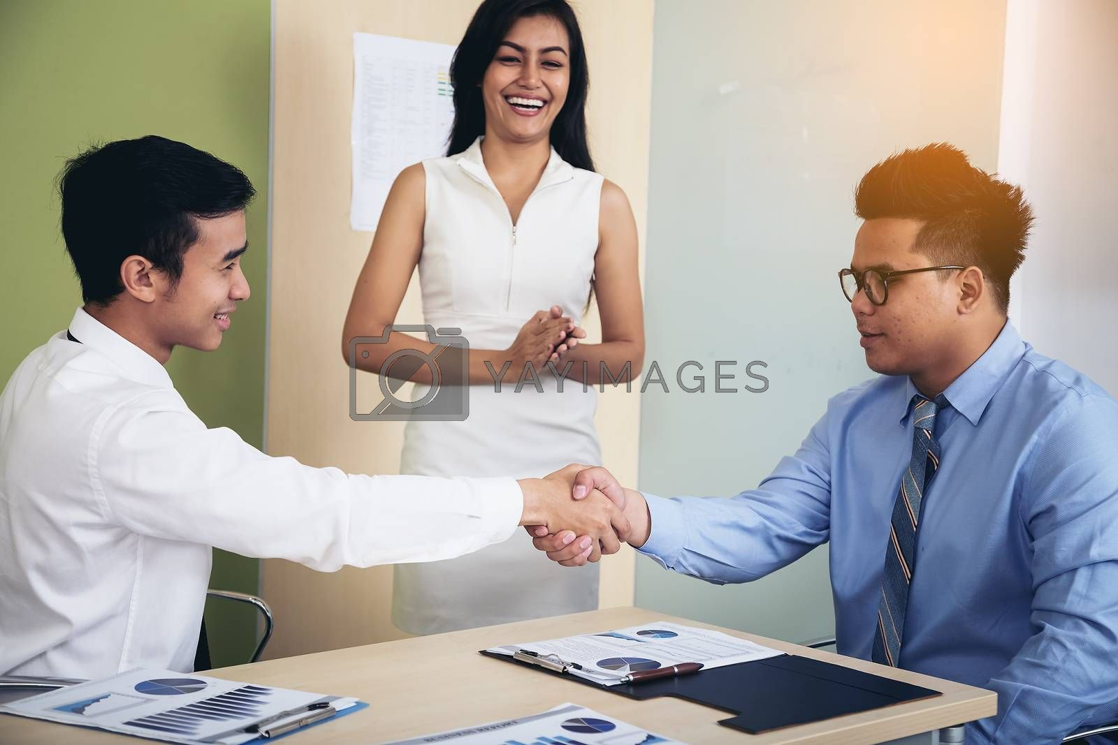 Image of a businessman joining hands after agreeing to a busines by numberone9018