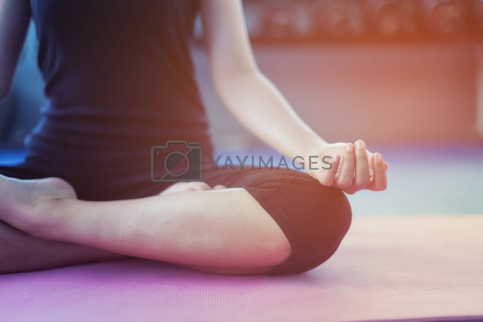 Beautiful girls exercise with yoga in public gym.