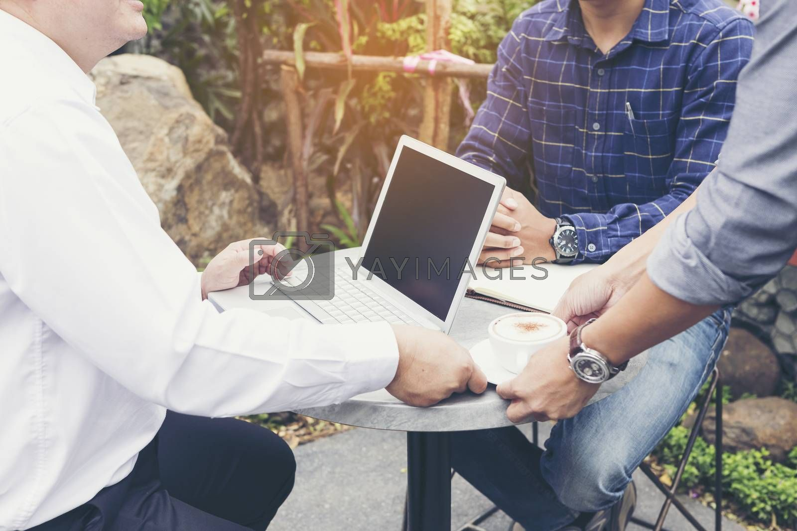 Businessmen are negotiating casual business in a coffee shop.