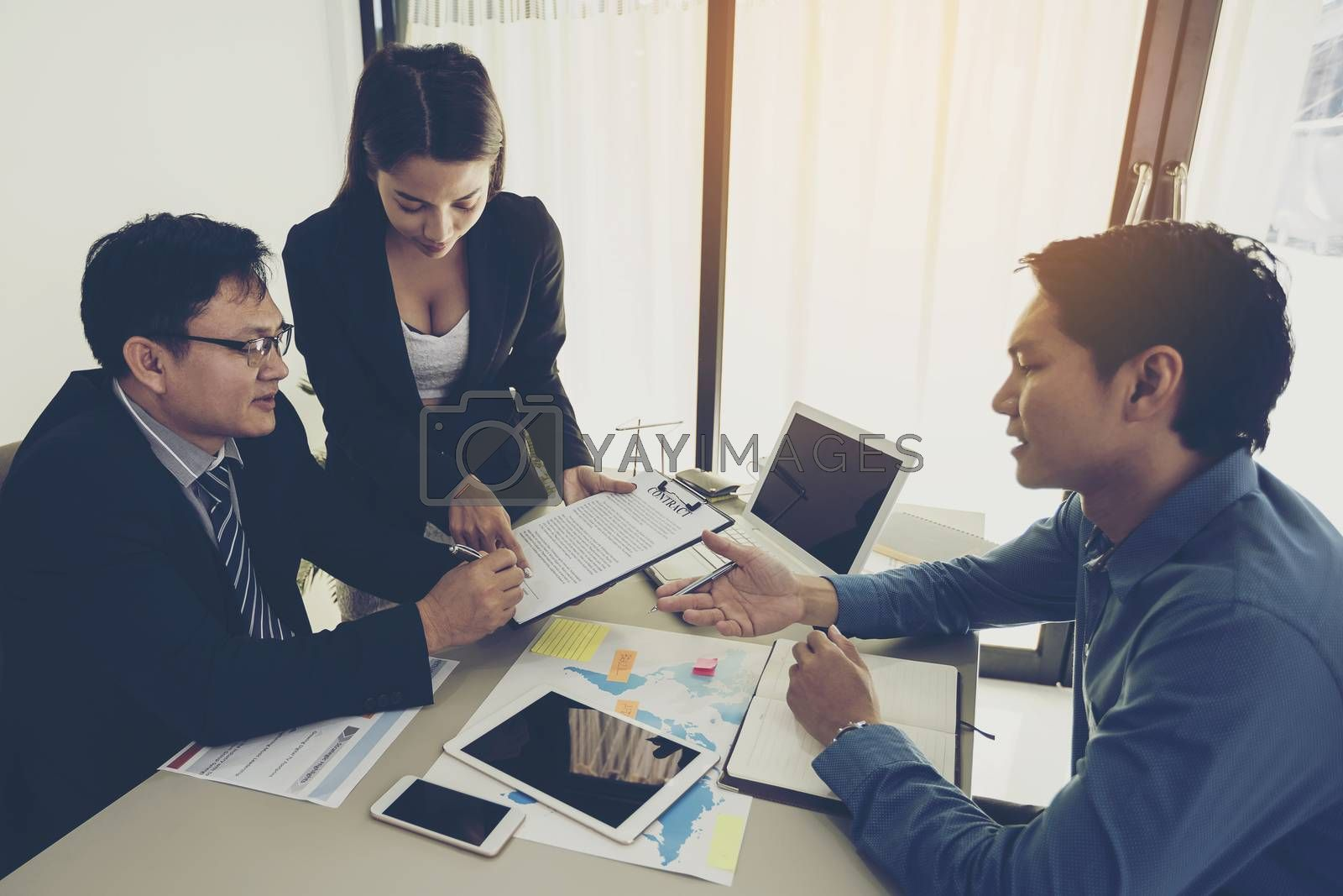 Business people are negotiating a business and signing a business agreement.