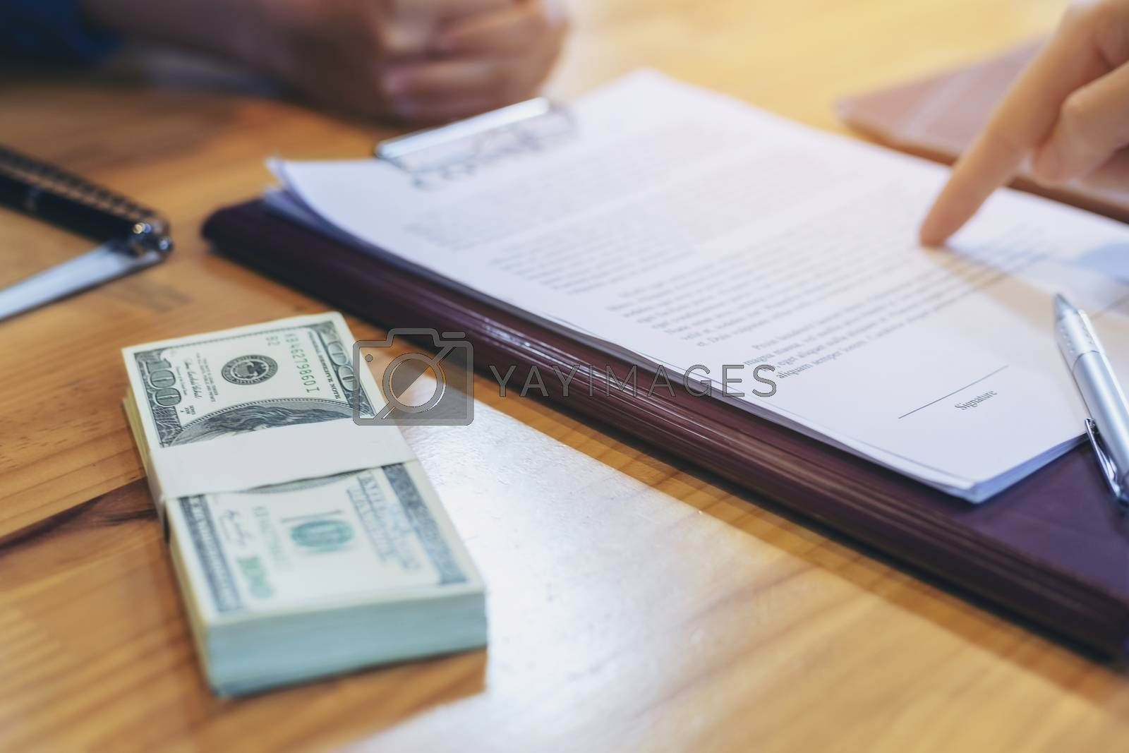 Businessman is signing a contract, business contract details, Signing and selling contracts