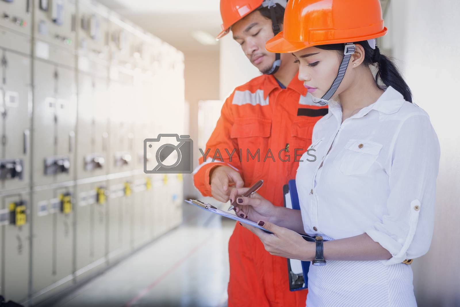 Executives and Electrical Engineers are checking the electrical equipment for their readiness.