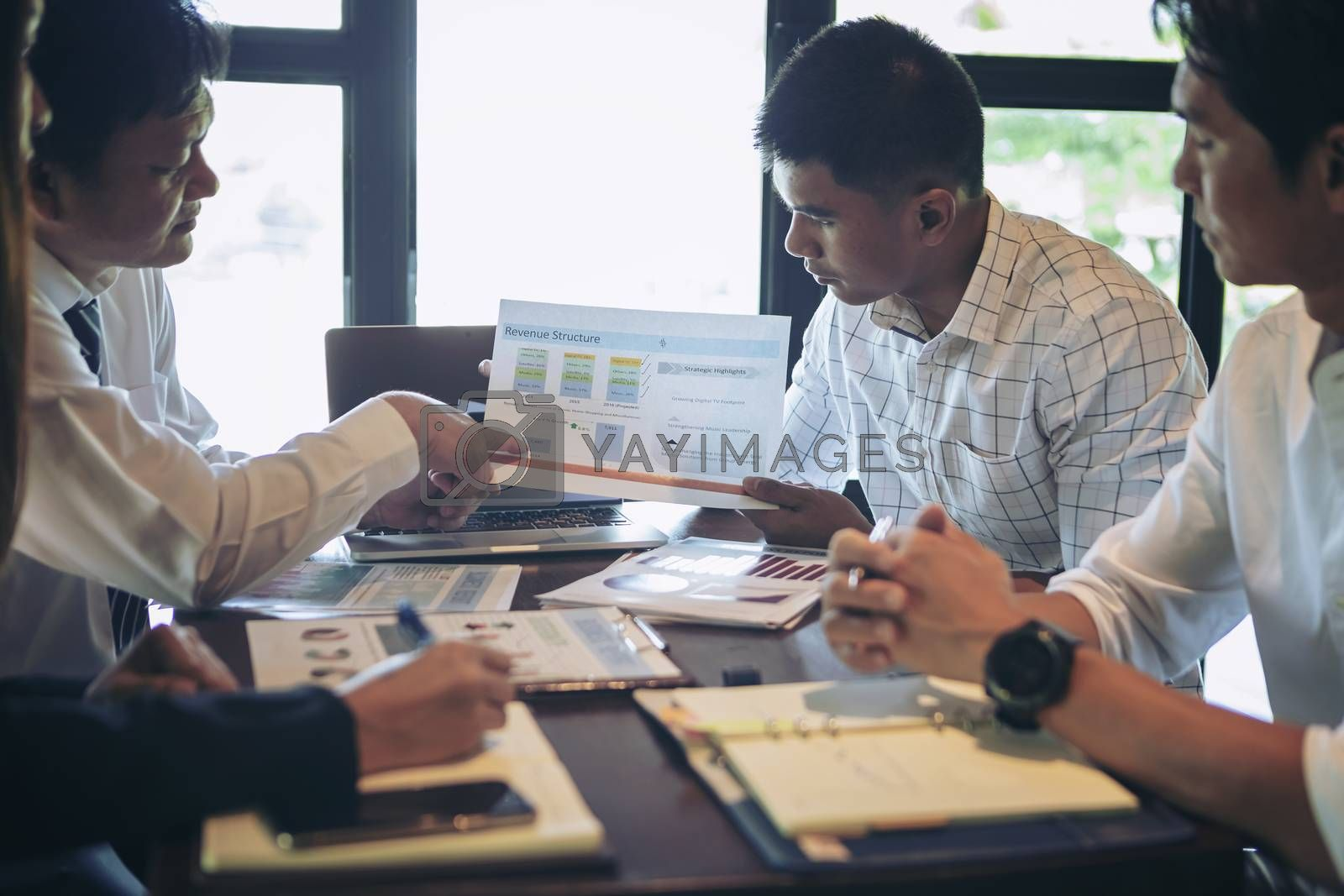Successful businessman boss presenting new project to employees, businessman giving presentation to clients in meeting room, team leader reporting about work explaining result on flipchart.