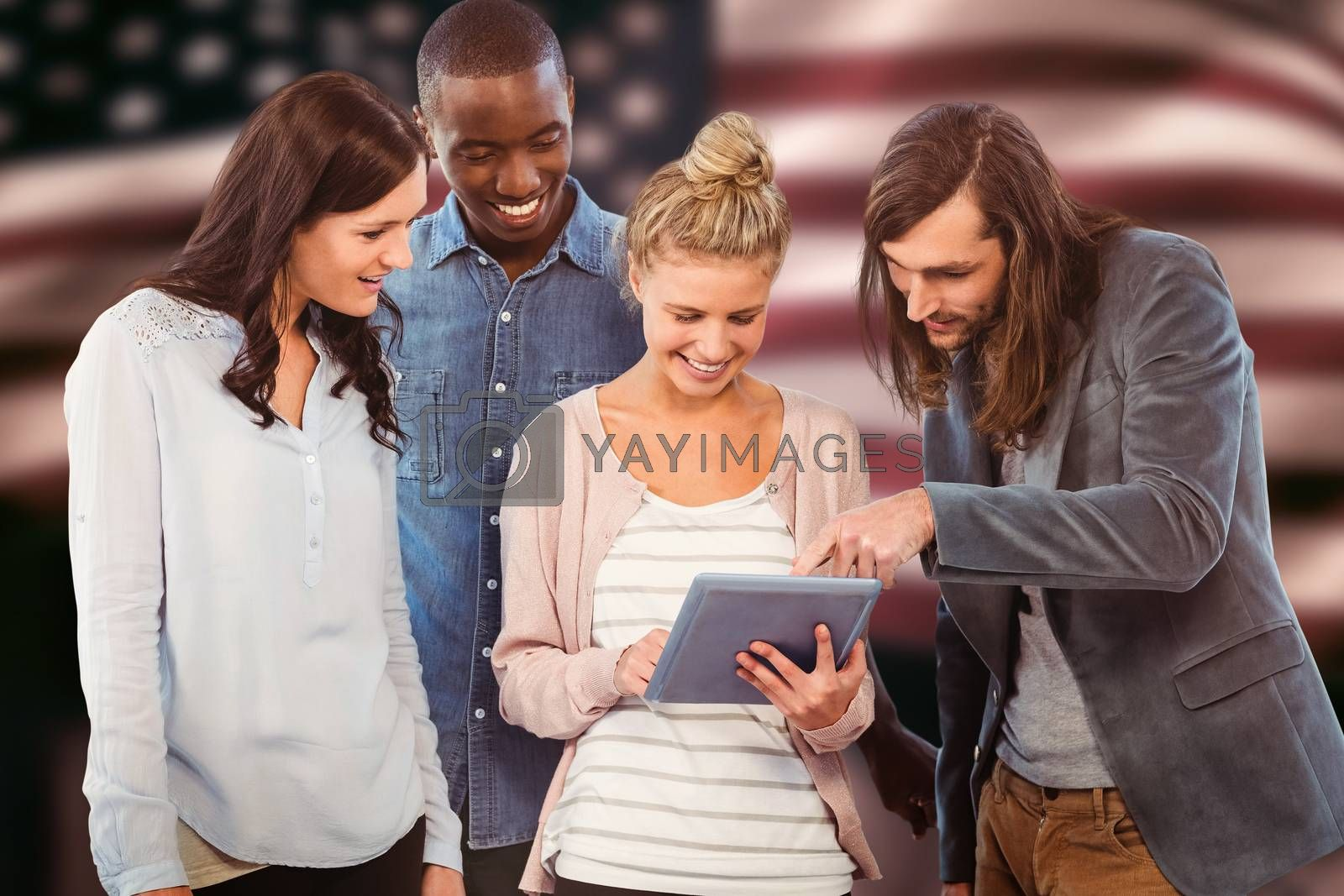 Happy woman holding digital tablet and discussing with coworkers  against composite image of digitally generated united states national flag