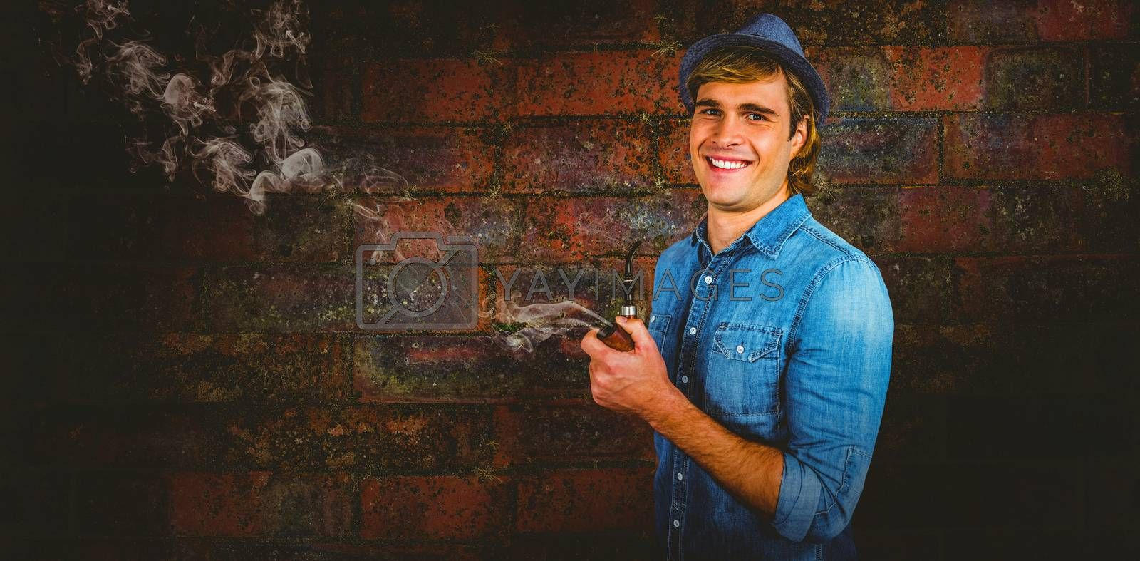 Composite image of cheerful hipster holding pipe by Wavebreakmedia