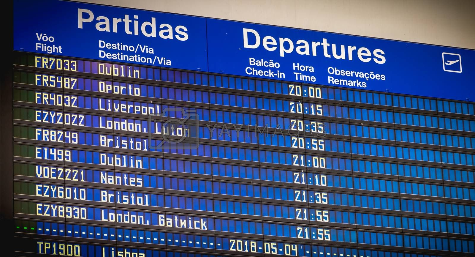 Faro, Portugal - May 3, 2018: billboards departing and arriving aircraft inside the international airport of Faro on a spring day