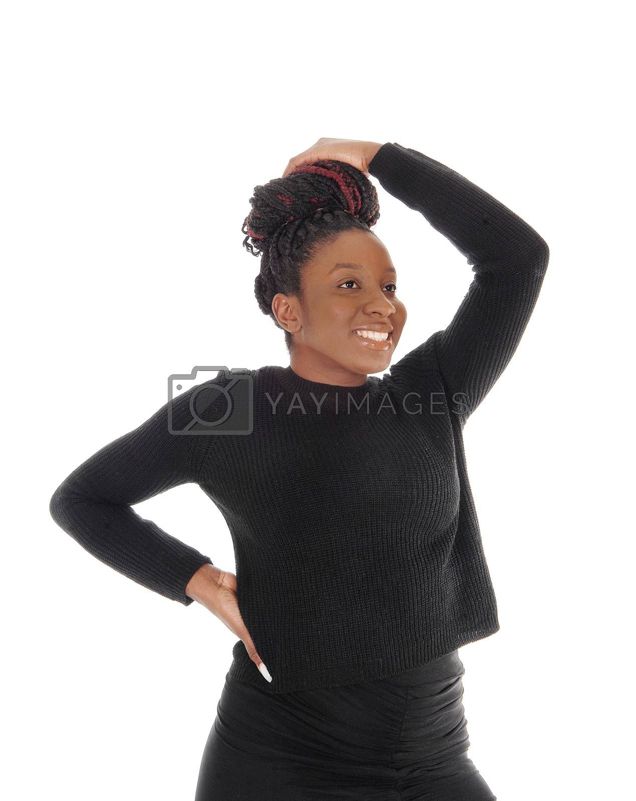 Beautiful African America woman standing in a black dress with one hand over her head, isolated for white background