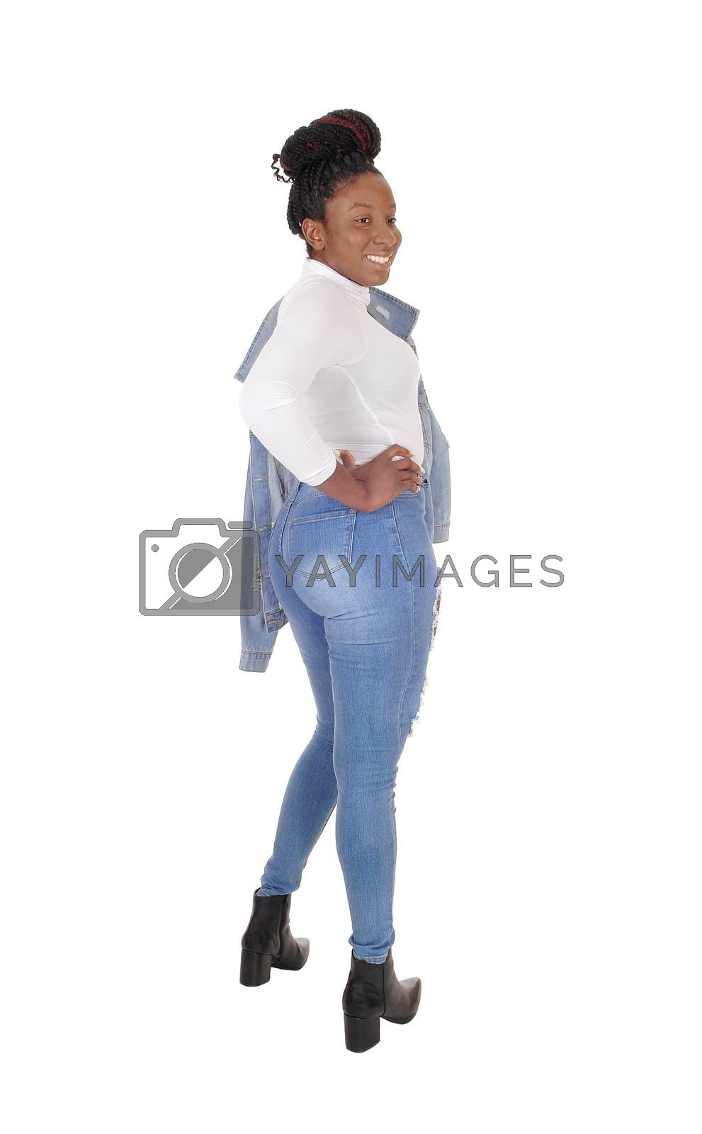 A tall young African American woman standing in jeans,  from the back, jacket over her shoulder, isolated for white background
