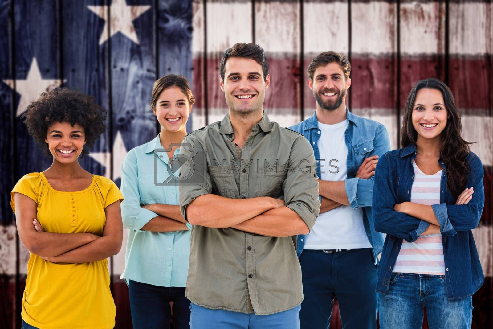 Group portrait of happy young colleagues against composite image of usa national flag