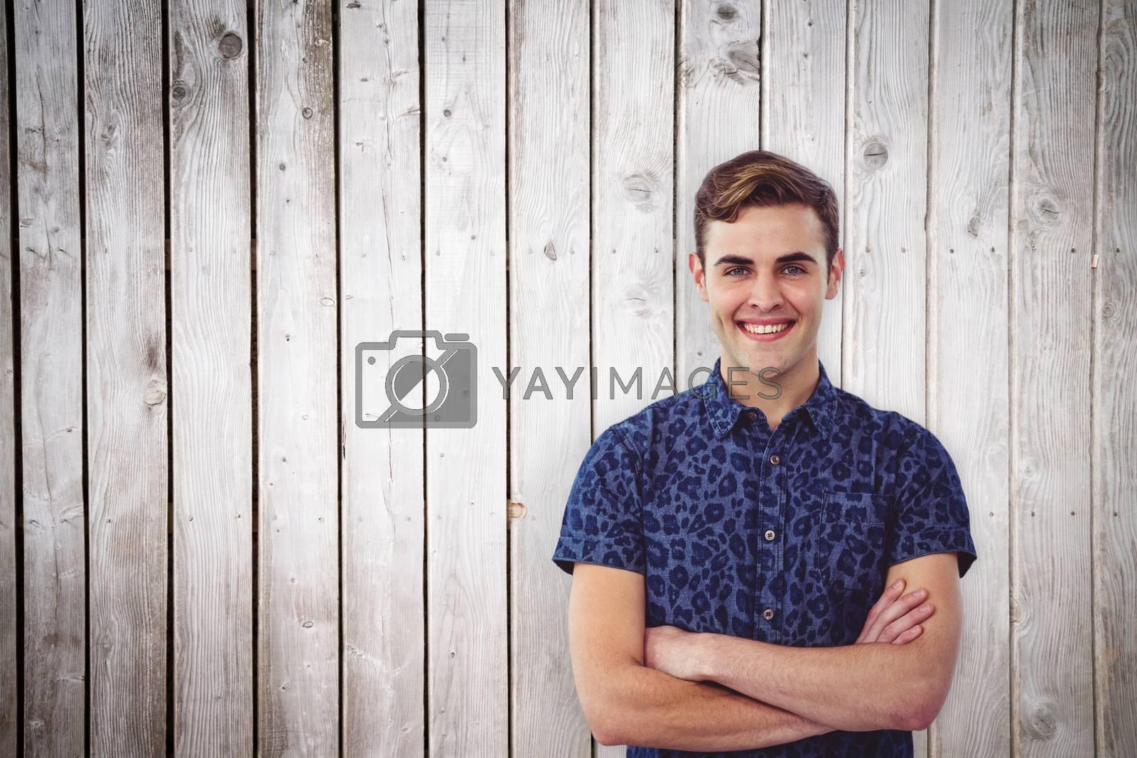 Handsome man against wooden planks