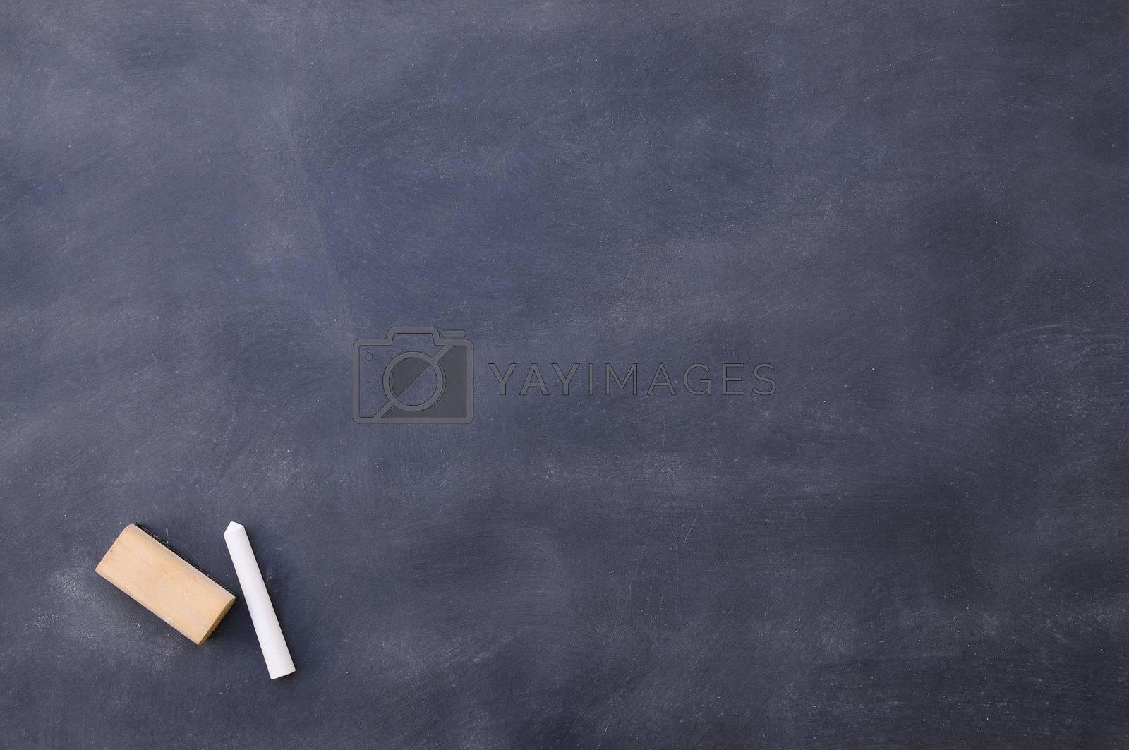 Dirty blackboard with chalk on school class.