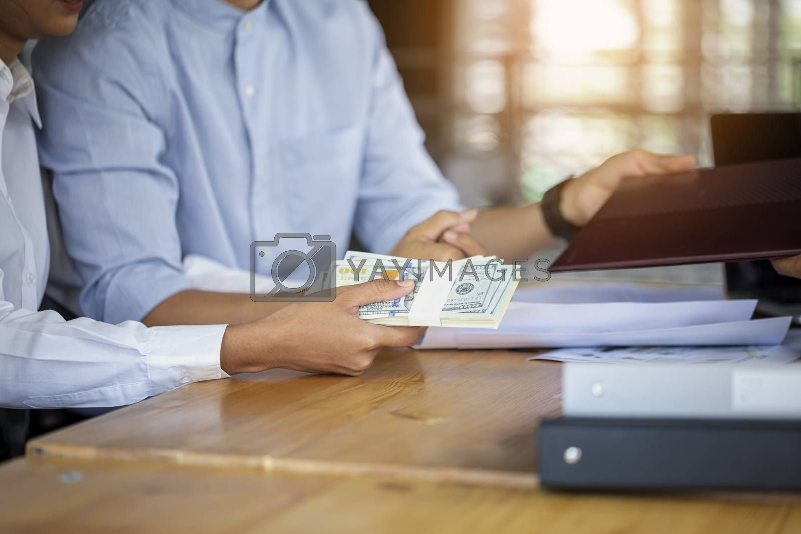 Married family couple happy smiling sign a contract paper document. Smiling couple talking with financial advisor about house loan