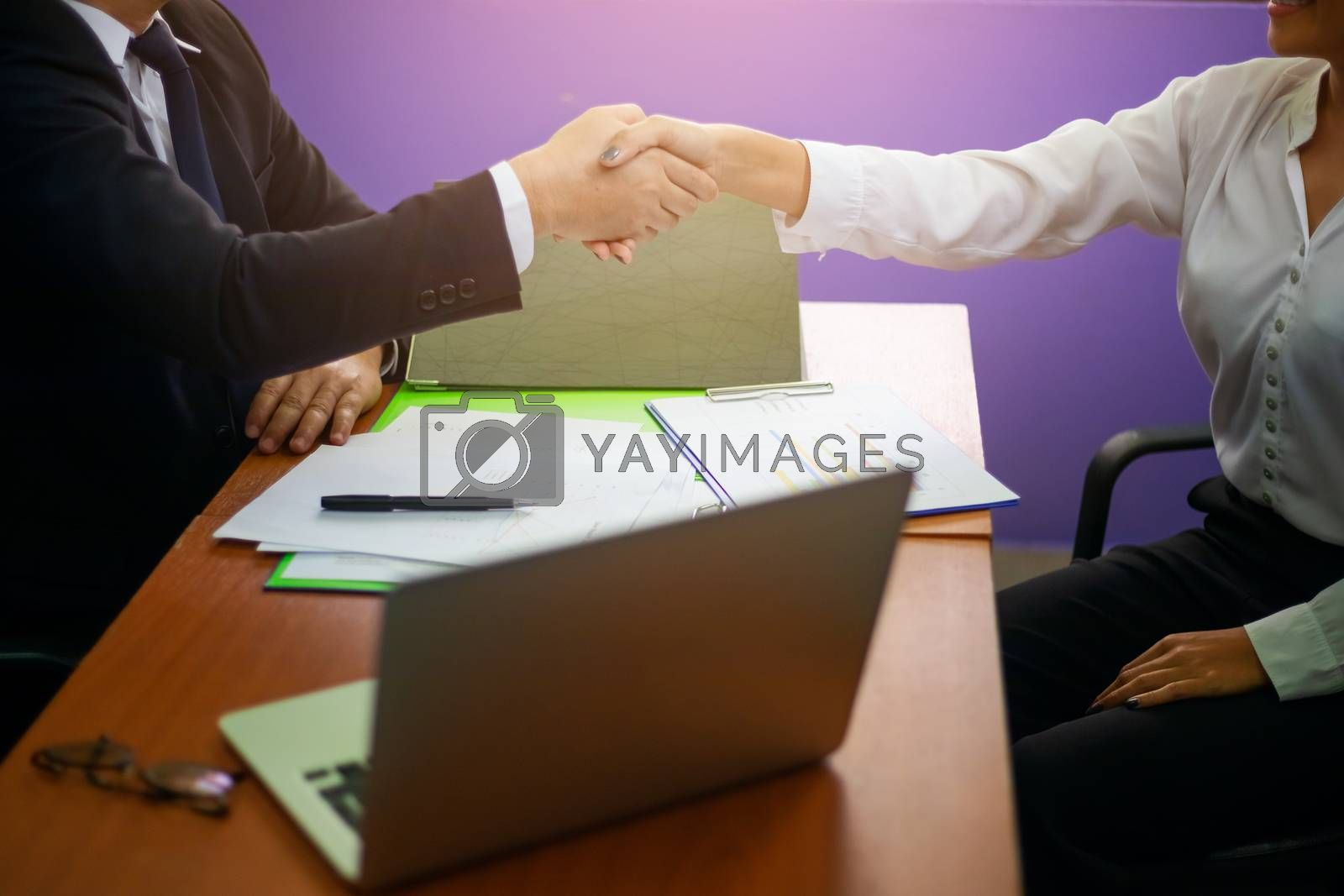 Close up hand of two businessman shaking hand after finish agreement and successful negotiations in office