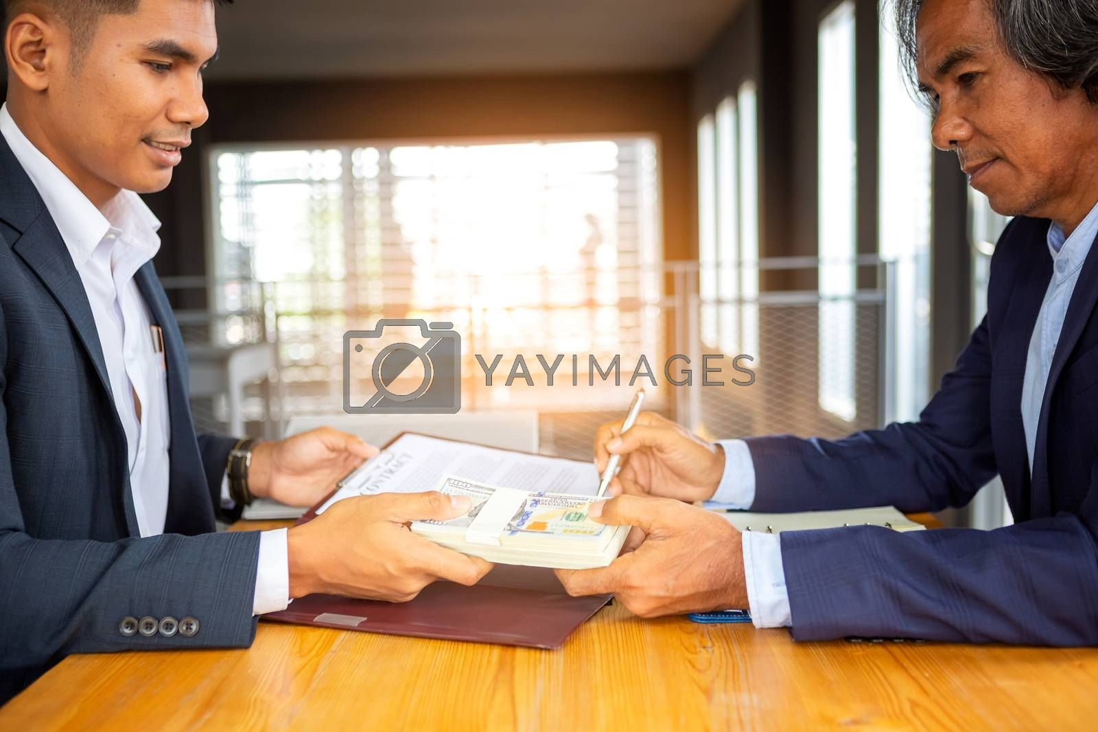 Close up business man signing contract making a deal. Business contract. agreement was signed co-investment business