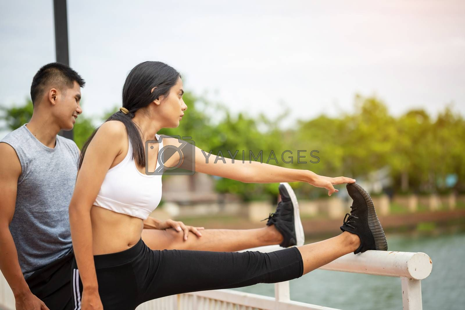 Couples who take care of their health by exercising happily in the city. Health care concept